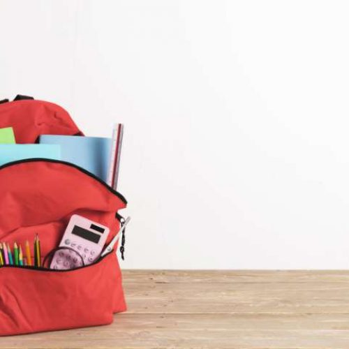 red-school-bag-with-essential-supplies